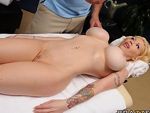 Blonde bombshell Candy Manson is oiled..